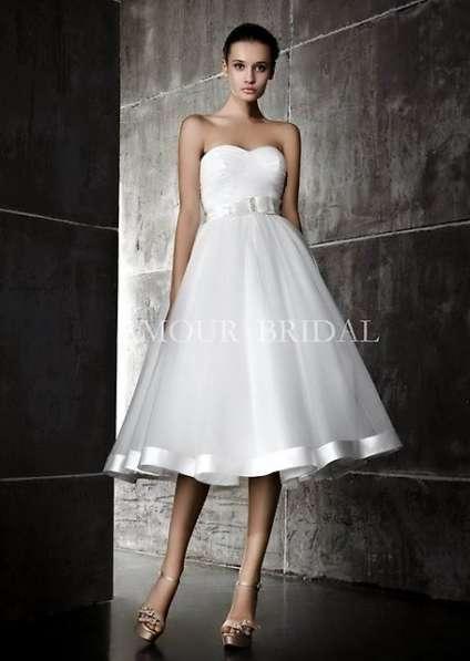 Продам свадебные платья новые