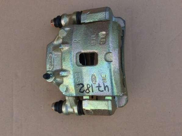 Суппорт пер. правый 58130FDA00 KIA RIO R-13